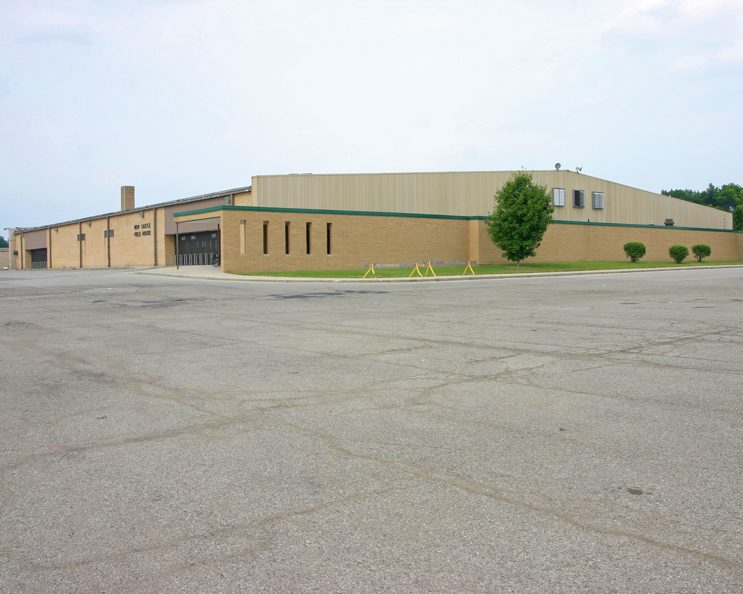 Exterior of the New Castle High School Fieldhouse. Built in 1959, this gymnasium is the worlds largest high school basketball gym holding 9,325 spectators, half the town's population.  Indiana is home to nine of the USA's 10 largest high school basketball arenas, but the Fieldhouse is the biggest of them all.
